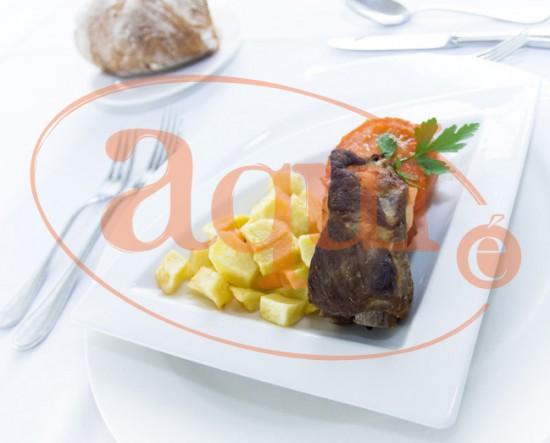 Costilla de cerdo y tomates asados
