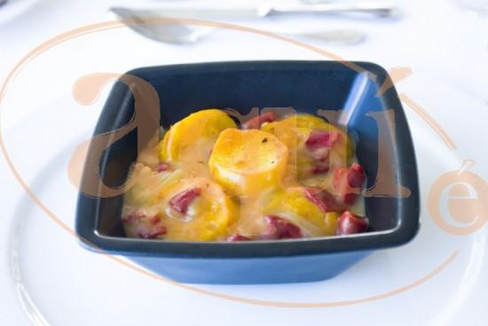 Patatas asadas con salsa de pimientos de piquillo